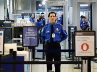 A TSA agent waits for passengers to use the TSA PreCheck lane being implemented by the Transportation Security Administration at Miami International Airport on October 4, 2011 in Miami, Florida. The pilot program launched today for fliers to use the expedited security screening in Miami, Atlanta, Detroit and Dallas/Fort Worth.The …