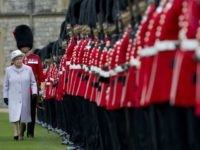 Britain's Queen Elizabeth II (L) inspects the Parade during a ceremony to present New Colours to the 1st Battalion and No. 7 Company the Coldstream Guards at Windsor Castle, Berkshire, west of London, on May 3, 2012. The Queen presented New Colours to the 1st Battalion and No. 7 Company …