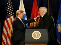 President Donald Trump, left, embraces West Virginia Governor Jim Justice during his remarks at a Salute to Service charity dinner in conjunction with the PGA Tour's Greenbrier Classic at The Greenbrier in White Sulphur Springs, W.Va., Tuesday, July 3, 2018. Trump celebrated active-duty service members and veterans during a military …