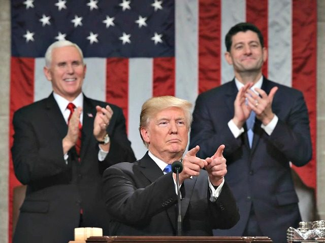 Trump delivers the State of the Union address as Pence and Ryan look on in the House chamber.