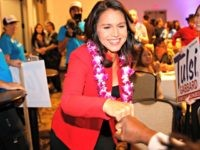 Rep. Tulsi Gabbard, D-Hawaii, greets supporters Tuesday, Nov. 6, 2018, in Honolulu.