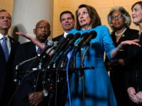 WASHINGTON, DC - NOVEMBER 28: U.S. House Minority Leader Rep. Nancy Pelosi (D-CA) (4th L) speaks to members of the media as (L-R) Rep. Adam Schiff (D-CA), Rep. John Lewis (D-GA), Rep. Eric Swalwell (D-CA), Rep. Joyce Beatty (D-OH), and Rep. Kathy Castor (D-FL) listen at the lobby of Longworth …