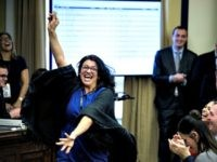 US Representative-elect Rashida Tlaib (D-MI) reacts to a good number during an office lottery for new members of Congress on Capitol Hill November 30, 2018 in Washington, DC.