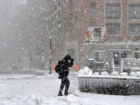 A man makes his way through the storm in Boston during a March noreaster snow storm on March 13, 2018 in Boston, Massachusetts.