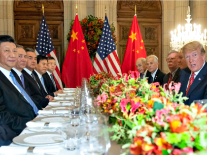 "US President Donald Trump (R) and China""s President Xi Jinping (L) along with members of their delegations, have dinner at the end of the G20 Leaders"" Summit in Buenos Aires, on December 01, 2018. – US President Donald Trump and his Chinese counterpart Xi Jinping had the future of their …"
