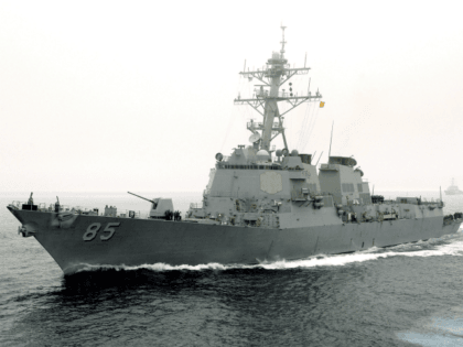 In this handout provided by the U.S. Navy and released on March 26, 2005, the guided-missile destroyer USS McCampbell (DDG 85) is seen July 26, 2005 in the Pacific Ocean. The Kiribati-flagged merchant vessel M/V Rokya 1 and the USS McCampbell (DDG 85) collided late March 25, 2006 approximately 30 …