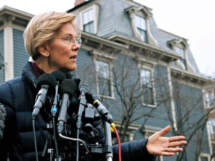 Sen. Elizabeth Warren, D-Mass., speaks outside her home, Monday, Dec. 31, 2018, in Cambridge, Mass. Warren on Monday took the first major step toward launching a widely anticipated campaign for the presidency, hoping her reputation as a populist fighter can help her navigate a Democratic field that could include nearly …