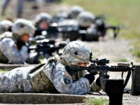 Female soldiers train on a firing range while wearing new body armor in September in Fort Campbell, Ky.