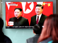 SEOUL, SOUTH KOREA - MARCH 28: South Koreans watch a television broadcast reporting the North Korean leader Kim Jong-un meet Chinese President Xi Jinping at Seoul Railway Station on March 28, 2018 in Seoul, South Korea. (Photo by Chung Sung-Jun/Getty Images)