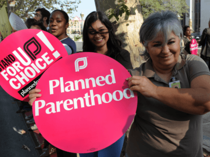 Members of the 'Planned Parenthood' women's rights group protest against the 'Stupak Ammendment' which they say will ban private abortion coverage for millions of American women, outside the Federal Courthouse in Los Angeles on November 20, 2009. Rights advocates have accused the most pro-choice US government in decades of throwing …