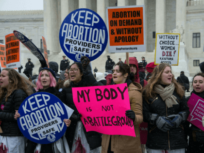 Pro-abortion activists gather in front of the US Supreme Court in Washington, DC, 0n January 22, 2016 as the country marks the 43rd anniversary of the Roe v Wasde Supreme Court decision which legalized abortion. / AFP / Nicholas Kamm (Photo credit should read NICHOLAS KAMM/AFP/Getty Images)