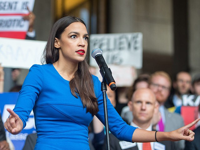 BOSTON, MA - OCTOBER 01: New York Democratic congressional candidate Alexandria Ocasio-Cortez speaks at a rally calling on Sen. Jeff Flake (R-AZ) to reject Judge Brett Kavanaugh's nomination to the Supreme Court on October 1, 2018 in Boston, Massachusetts. Sen. Flake is scheduled to give a talk at the Forbes …