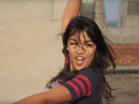 "The video appears to be an edited version of the ""Boston University Brat Pack Mashup,"" which features Ocasio-Cortez on a rooftop recreating the dance scene from ""The Breakfast Club"" alongside other students. (YouTube / Julian Jensen)"