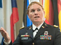 "Transgender US Army Reseve Captain Sage Fox speaks during a conference entitled ""Perspectives on Transgender Military Service from Around the Globe"" organized by the American Civil Liberties Union (ACLU) and the Palm Center in Washington on October 20, 2014. Transgender military personnel from 18 countries who allow them to serve …"