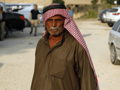A Palestinian Bedouin stands in the village of Khan al-Ahmar in the Israeli occupied West Bank on September 13, 2018. - Israeli troops removed caravans early today from near the Bedouin village which they have orders to demolish despite international criticism, officials said. (Photo by AHMAD GHARABLI / AFP) (Photo …