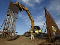"Construction crews install new border wall sections Wednesday, Jan. 9, 2019, seen from Tijuana, Mexico. U.S. President Donald Trump walked out of his negotiating meeting with congressional leaders Wednesday — ""I said bye-bye,"" he tweeted— as efforts to end the 19-day partial government shutdown fell into deeper disarray over his …"