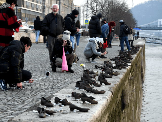 Tourists take pictures at the 'Shoes statue of a memorial place of the Holocaust victims' on the bank of the Danube River in downtown of Budapest on February 7, 2018. Thousands of Hungarians were shot and thrown into the river by the Nazis and the Hungarian Nazis collaborators in 1944. …