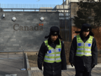 Police patrol outside the Canadian embassy in Beijing on January 15, 2019. - A Chinese court sentenced a Canadian man to death on drug trafficking charges on January 14 after his previous 15-year prison sentence was deemed too lenient, deepening a diplomatic rift as Canadian premier Justin Trudeau accused Beijing …