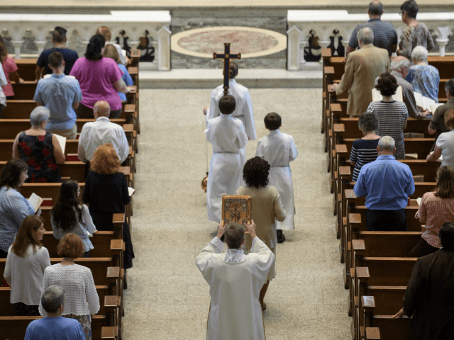 PITTSBURGH, PA - AUGUST 15: Parishioners worship during a mass to celebrate the Assumption of the Blessed Virgin Mary at St Paul Cathedral, the mother church of the Pittsburgh Diocese on August 15, 2018 in Pittsburgh, Pennsylvania. The Pittsburgh Diocese was rocked by revelations of abuse by priests the day …