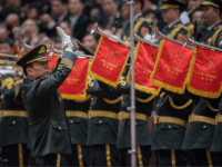 Members of a military band play the national anthem during the fifth plenary session of the first session of the 13th National People's Congress (NPC) at the Great Hall of the People in Beijing on March 17, 2018. China's rubber-stamp parliament unanimously handed President Xi Jinping a second term on …