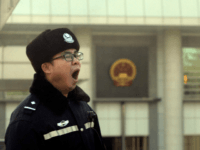 Right to remain silent: A policeman yawns while standing guard outside the Beijing court where prominent Chinese legal activist Xu Zhiyong was sentenced to four years in prison for his role in organizing protests, furthering a crackdown on a rights movement he championed. | AFP-JIJI