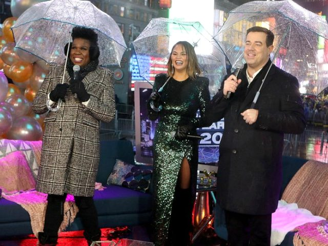 Chrissy Teigen Collides with Leslie Jones' Umbrella to Start 2019