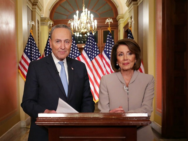 WASHINGTON, DC - JANUARY 08: Speaker of the House Nancy Pelosi (D-CA) (R) and Senate Minority Leader Charles Schumer (D-NY) pose for photographs after delivering a televised response to President Donald Trump's national address about border security at the U.S. Capitol January 08, 2019 in Washington, DC. Republicans and Democrats …