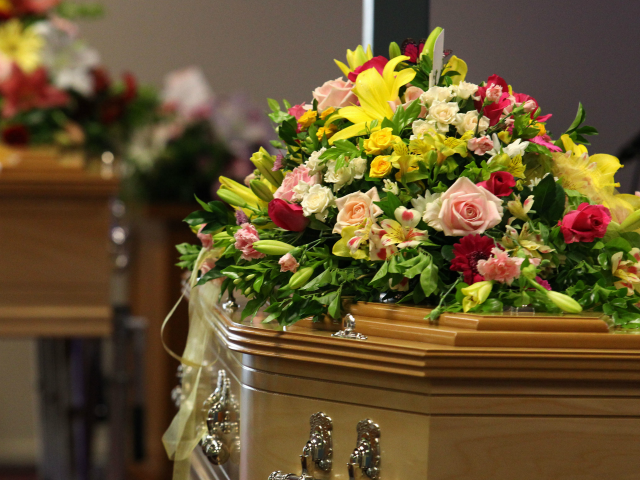Flowers cover the coffins at the funeral of Noelene and Yvana Bischoff at the Gatton Baptist church on January 20, 2014 in Gatton, Queensland, Australia. The mother and daughter were farewelled at the funeral service after they fell fatally ill while on holiday in Bali. (Photo by Tertius Pickard-Pool/Getty Images)
