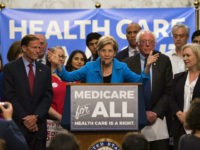 US Senator Elizabeth Warren (C), Democrat from Massachusetts, speaks with US Senator Bernie Sanders (2nd R), Independent from Vermont, as they discusses Medicare for All legislation on Capitol Hill in Washington, DC, on September 13, 2017. The former US presidential hopeful introduced a plan for government-sponsored universal health care, a …