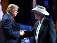 US President Donald Trump shakes hands with Arizona farmer Jim Chilton during the annual American Farm Bureau Federation convention in the Ernest N. Morial Convention Center in New Orleans, Louisiana on January 14, 2019. (Photo by MANDEL NGAN / AFP) (Photo credit should read MANDEL NGAN/AFP/Getty Images)