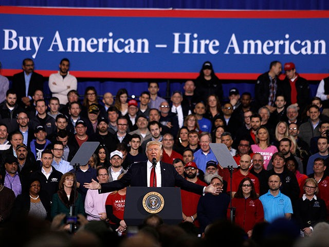 YPSILANTI, MI- MARCH 15: U.S. President Donald Trump speaks to auto workers at the American Center for Mobility March 15, 2017 in Ypsilanti, Michigan. Trump discussed his priorities of improving conditions to bolster the manufacturing industry and reduce the outsourcing of American jobs. (Photo by Bill Pugliano/Getty Images)