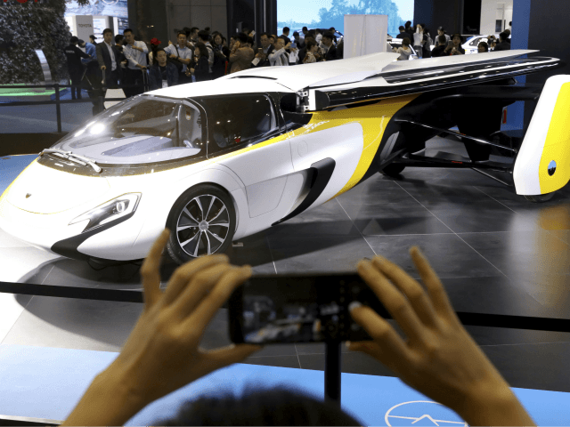 A visitor takes a photo of the Aeromobil, a flying car from Slovakia, during the China International Import Expo in Shanghai, Monday, Nov. 5, 2018. Chinese President Xi Jinping has promised to open China's market wider as he opened a trade fair meant to promote the country's image as an …