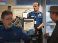 CHICAGO, ILLINOIS - JANUARY 07: A Transportation Security Administration (TSA) worker screens passengers and airport employees at O'Hare International Airport on January 07, 2019 in Chicago, Illinois. TSA employees are currently working under the threat of not receiving their next paychecks, scheduled for January 11, because of the partial government …