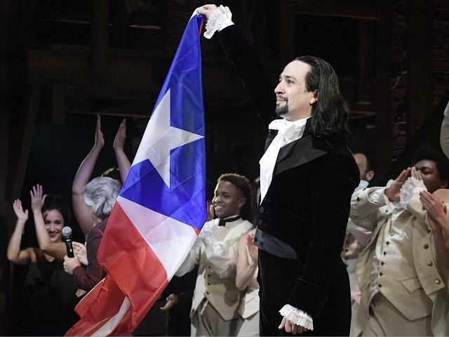 Lin-Manuel Miranda, composer and creator of the award-winning Broadway musical, Hamilton, proudly waves a Puerto Rican flag after receiving a standing ovation at the end of the play's premiere held at the Santurce Fine Arts Center, in San Juan, Puerto Rico, Friday, Jan. 11, 2019. The musical is set to …