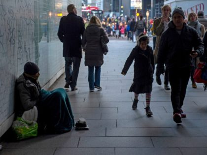 Having previously worked in his family's minicab business, Abdul, aged 40, from London, sits in an underpass near to Waterloo Station, on December 27, 2018, having spent the past two weeks sleeping rough near the South bank centre in central London - Nearly 600 homeless people in England and Wales …