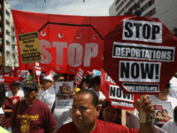 LOS ANGELES, CA - MAY 1: Marchers rally under the Chinatown Gateway before marching to the Metropolitan Detention Center during one a several May Day immigration-themed events on May 1, 2014 in Los Angeles, California. Demonstrators are calling for immigration reform and an end to deportations of undocumented residents. (Photo …