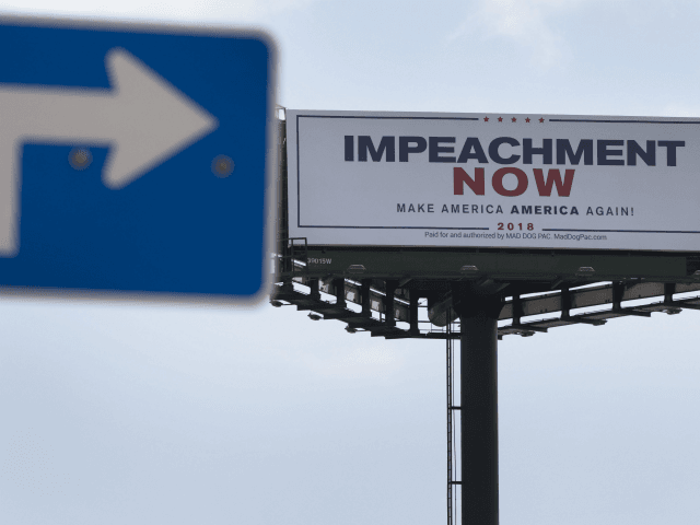 MARCH 19: A billboard reading: 'Impeachment Now Make America America Again!' calling for President Donald Trump's impeachment is seen along a street leading to Mar-A-Lago on March 19, 2018 in West Palm Beach, Florida. The sign was installed by The Mad Dog PAC and is along the road President Donald …