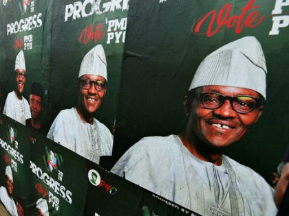A picture taken January 16, 2019, shows a wall plastered with campaign posters of Nigeria's incumbent president and candidate from the ruling All Progressives Congress (APC) party, Muhammadu Buhari, ahead of the country's general elections next February. (Photo by PIUS UTOMI EKPEI / AFP) (Photo credit should read PIUS UTOMI …