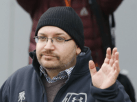 In this Jan. 20, 2016, file photo, Washington Post reporter Jason Rezaian waves at Landstuhl Regional Medical Center in Landstuhl, Germany. Rezaian says he was arrested by Iranian authorities, subjected to a sham trial and held for 18 months purely as a way to gain leverage over the American government …