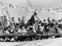 17th June 1946: The 'Haviva Reik', a small ship containing some 450 Jewish refugees, on arrival at Haifa on 8th June, after a dangerous journey across the Mediterranean. The banner in hebrew reads 'Keep the gates open, we are not the last.' (Photo by Keystone/Getty Images)