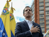 """Venezuela's National Assembly head Juan Guaido declares himself the country's """"acting president"""" during a mass opposition rally against leader Nicolas Maduro, on the anniversary of the 1958 uprising that overthrew military dictatorship, in Caracas on Wednesday. 