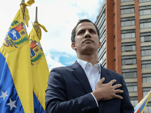 "Venezuela's National Assembly head Juan Guaido declares himself the country's ""acting president"" during a mass opposition rally against leader Nicolas Maduro, on the anniversary of the 1958 uprising that overthrew military dictatorship, in Caracas on Wednesday. 