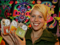 Full Moon store owner Chloe Collette poses with some of magic mushrooms she has for sale in Amsterdam, Netherlands, Thursday Aug. 2, 2007. It's high season for tourists, but for many the emphasis is on the word high. Thousands come specifically to smoke marijuana without fear of getting into trouble …