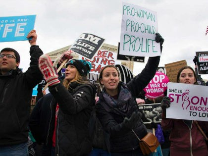 Pro-life activists wave for others to join as they demonstrate in front of the US Supreme Court during the March For Life in Washington, DC, January 27, 2017.. Anti-abortion advocates descended on the US capital on Friday for an annual march expected to draw the largest crowd in years, with …