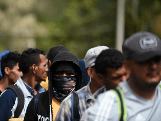 Honduran migrants heading to the United States with a second caravan wait in Agua Caliente, Chiquimula region, Guatemala, on the Honduras-Guatemala border on January 16, 2019. - Hundreds of Hondurans have set out on a trek to the United States, forming another caravan, which US President Donald Trump cited Tuesday …