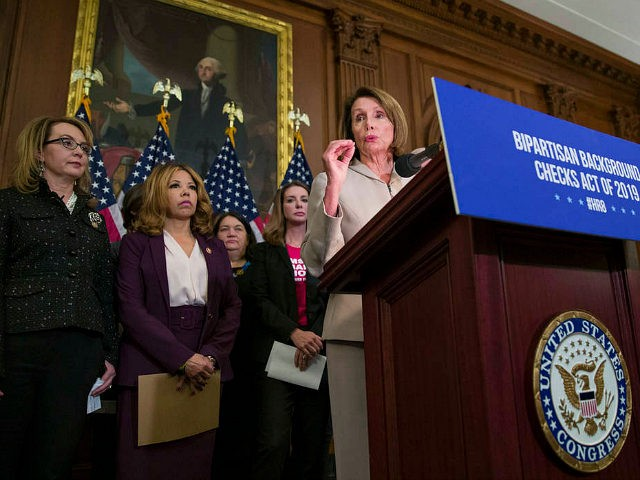 House Speaker Nancy Pelosi of Calif., center, speaks accompanied by gun violence victim former Rep. Gabby Giffords, left, Rep. Lucy McBath, D-Ga., and Shannon Watts, who founded Moms Demand Action, second from right, to announce the introduction of bipartisan legislation to expand background checks for sales and transfers of firearms, …