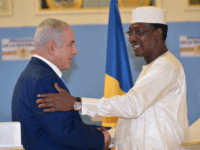 Chadian President Idriss Deby Itno (R) shakes hands with Israeli Prime Minister Benjamin Netanyahu during a meeting at the presidential palace in N'Djamena on January 20, 2019. - Israel and Chad have renewed diplomatic ties decades after they were ruptured, Israel's prime minister announced on January 20 during a visit …