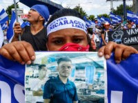 CORRECTS BYLINE - A protestor holds a photo of one of the victims of the deadly protests during an anti-government march in Managua, Nicaragua, Saturday, Aug. 11, 2018. The current unrest began in April, when President Daniel Ortega imposed cuts to the social security system and small protests by senior …