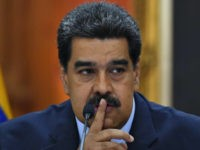 Venezuela's President Nicolas Maduro speaks gestures during a press conference, where he warned the Lima Group that he would take energetic measures if they do not rectify their position on Venezuela in 48 hours, on the eve of assuming a new six-year mandate, at the Miraflores presidential palace in Caracas, …