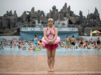 TOPSHOT - In this photo taken on July 21, 2017, swimmer Ri Song-Hui (21) poses for a portrait at the Munsu Water Park in Pyongyang. / AFP PHOTO / Ed JONES (Photo credit should read ED JONES/AFP/Getty Images)
